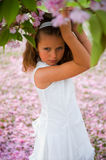 Fairytale girl. Cute little girl holding a branch of a Japanese cherry blossom tree Stock Images