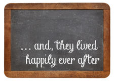 Fairytale happy end phrase. And, they lived happily ever after -  stock phrase for ending oral narratives or fairytale on a vintage blackboard Royalty Free Stock Photos