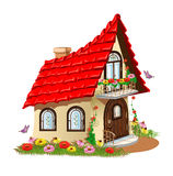 Fairytale house with a balcony with flowers. Isolated on white background Royalty Free Stock Image