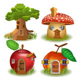 Fairytale houses. Cartoon illustration of a tree house, mushroom house, apple house and peach house, isolated on a white background Royalty Free Stock Images