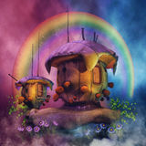 Fairytale houses with flowers and rainbow Stock Photography