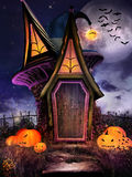 Fairytale hut with pumpkins Royalty Free Stock Images