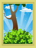 Fairytale landscape with clover and tree stock photography