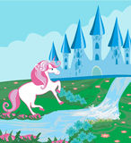 Fairytale landscape with magic castle and beautiful unicorn Stock Photo