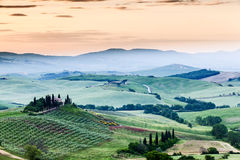 The fairytale landscape of Tuscany fields at sunrise Royalty Free Stock Photo