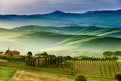 The fairytale landscape of Tuscany fields at sunrise royalty free stock photos