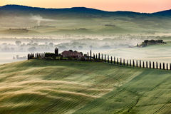 The fairytale landscape of Tuscany fields at sunrise stock image