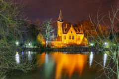 Fairytale night landscape at Lake Minnewater in Bruges, Belgium Royalty Free Stock Images