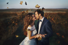 Fairytale romantic couple of newlyweds hugging at sunset in vine Stock Photo