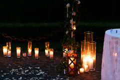 Fairytale romantic wedding aisle with white candles and petals i Stock Photography