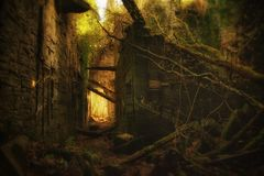 Fairytale ruin. Exploring the charming ruin of Buchanan Castle, Scotland, walking among lush overgrown vegetation and remnants of a time gone by royalty free stock images