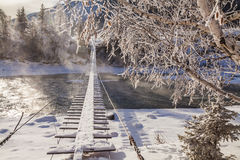 Fairytale snowy landscape with snow-covered bridge Royalty Free Stock Image