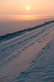 Fairytale sunset in fog and snow. A foggy snow landscape during sunset in a polder in the Netherlands Royalty Free Stock Image