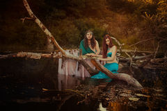 Fairytale woman sad. Fairytale women sad, men holding her hand, they are in a swamp Royalty Free Stock Image