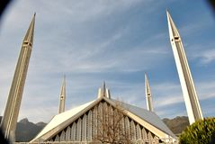 Faisal Mosque Islamabad. The eye-popping Shah Faisal Mosque Islamabad Pakistan nestled at the foot of the Margalla Hills, is one of Asia`s largest and reflects Stock Image