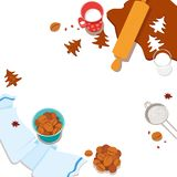 Faisant cuire et glaçant des biscuits de gingembre images libres de droits