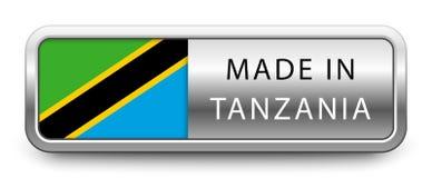 FAIT DANS l'insigne métallique de la TANZANIE avec le drapeau national d'isolement sur le fond blanc illustration libre de droits