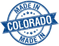 Fait dans le timbre rond bleu du Colorado illustration libre de droits