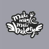 Faites la magie faire à boulangerie le lettrage blanc de calligraphie Photos stock