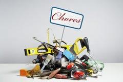 Faites-le vous-même des outils dans la pile sur le fond blanc Photographie stock libre de droits
