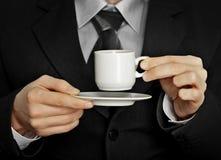 Faites une pause dans le travail - cuvette de café noir intense Photo stock