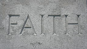 Faith. A stone engraving of the word faith Royalty Free Stock Images