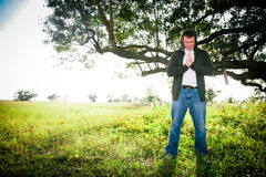 Faith. A man with hands clasped has a spiritual experience in the outdoors Royalty Free Stock Photos