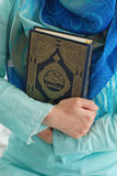 Faith. Muslim girl with Koran in hands Stock Images