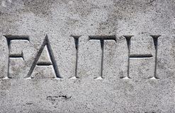 Faith. The Word Faith Written in Granite Stock Image