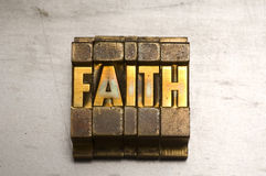 Faith. Brass / Gold colored Faith on silver metal background