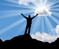 Faith. Silhouette of a man with his arms stretched out to the sun Stock Image