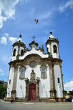 Faith is in the air. Beautiful bird is caught at the time of the photo in the city of Sao Joao del Rei in front of a wonderful church Stock Photo