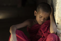 Faith Burma. Burmese novice Sitting sleep in Buddhist temple royalty free stock photography