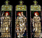 Faith, Charity and Hope in stained glass Stock Photography