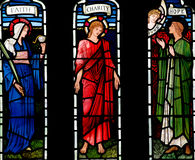 Faith, Charity and Hope in stained glass Royalty Free Stock Images