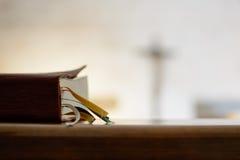 Faith church. Bible and faith with the backdrop of a cross Stock Photos