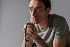 Serene male person being at his devotions stock image