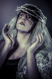 Faith concept, woman dressed in white veil and crown of thorns, Royalty Free Stock Photo