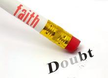 Faith erases doubt. Concept of pencil and eraser with faith erasing doubt Royalty Free Stock Image