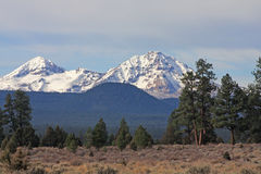 Faith and Hope In The Cascades. Among the most prominent peaks in the Central Oregon Cascades are, from left to right, (south to north,) Middle Sister (Hope Royalty Free Stock Image
