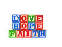 Faith, Hope, Love Letter Blocks Horizontal 1. The words FAITH, HOPE and LOVE spelled out horizontally using some old alphabet blocks Royalty Free Stock Photo