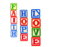 Faith, Hope, Love Letter Blocks Vertical 1. The words FAITH, HOPE and LOVE spelled out vertically using some old alphabet blocks Stock Images