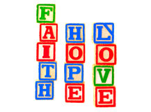 Faith, Hope, Love Letter Blocks Vertical 2. The words FAITH, HOPE and LOVE spelled out vertically using some old alphabet blocks Stock Images