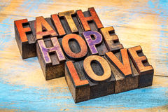Faith, hope and love typography stock image
