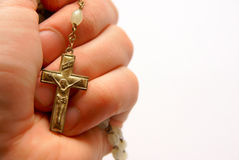 Faith Jesus Christ. Isolated hand of prayer with cross and Jesus Christ, religious background Stock Photo