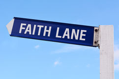 Faith Lane. Text on road sign against blue sky background. Concept photo of faith,love,hope, religion,spiritual,freedom,worship,help, heaven, believe, religious Royalty Free Stock Image