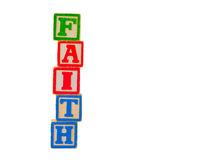 Faith Letter Blocks 2. The word FAITH spelled out vertically using some old alphabet blocks Stock Images