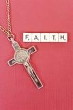 Faith in Religion. Faith Spelled With Letter Tiles Next To Cross stock photos