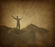 Faith and religion. With old grunge paper parchment represented by a man on a mountain with his arms raised to the heavens in search of belief and spirituality royalty free illustration
