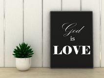 Faith religion concept. God is Love quotation in frame Stock Photos
